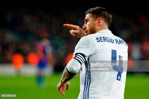 Real Madrid's defender Sergio Ramos celebrates after scoring the equalizer during the Spanish league football match FC Barcelona vs Real Madrid CF at...
