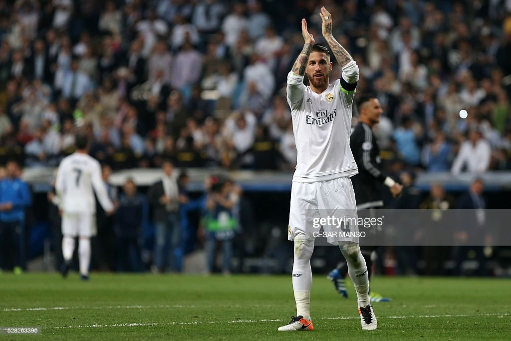 Real Madrid's defender Sergio Ramos celebrates their victory at the end of the UEFA Champions League semi-final second leg football match Real Madrid CF vs Manchester City FC at the Santiago Bernabeu stadium in Madrid, on May 4, 2016. / AFP / CESAR