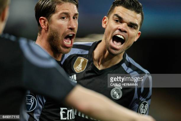 Real Madrid's defender Sergio Ramos celebrates with teammate Real Madrid's Portuguese defender Pepe after scoring during the UEFA Champions League...