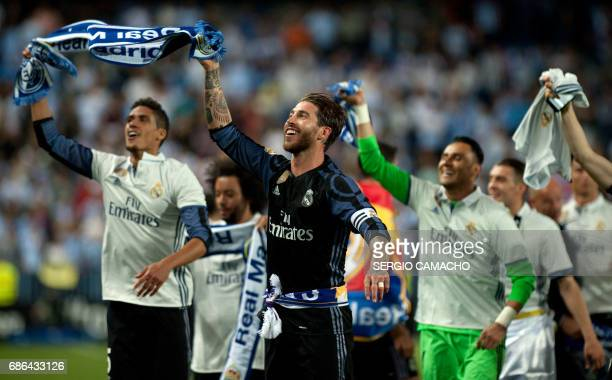 Real Madrid's defender Sergio Ramos celebrates with teammates at the end of the Spanish league football match Malaga CF vs Real Madrid at La Rosaleda...