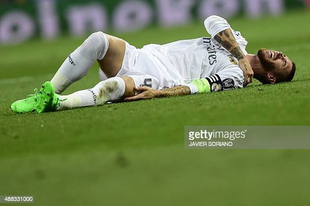 Real Madrid's defender Sergio Ramos complains on the ground during the UEFA Champions League group A football match Real Madrid CF vs FC Shakhtar...