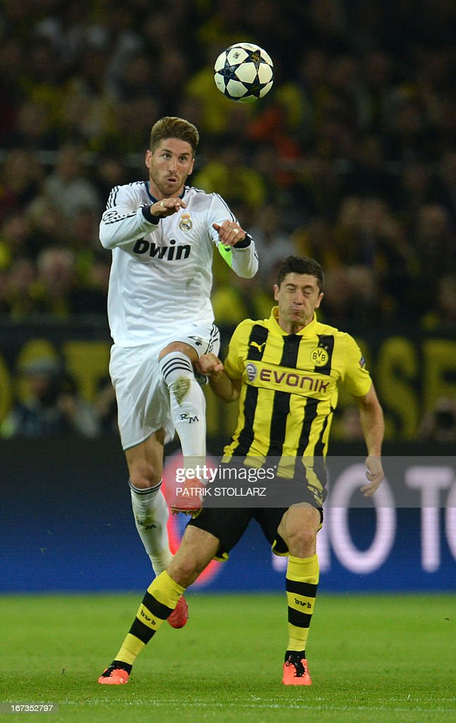 Real Madrid's defender Sergio Ramos (L) heads for the ball with Dortmund's Polish striker Robert Lewandowski during the UEFA Champions League semi final first leg football match between Borussia Dortmund and Real Madrid on April 24, 2013 in Dortmund, western Germany. Dortmund won the match 4-1.