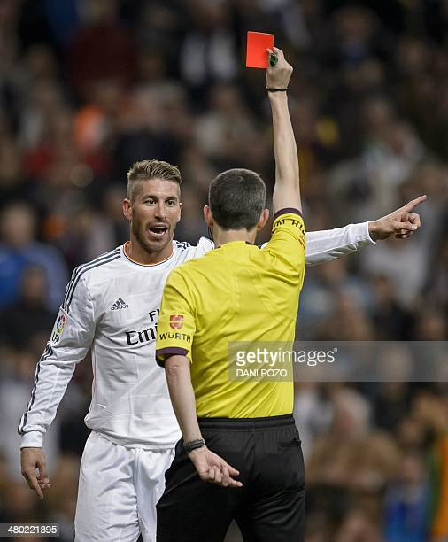 Real Madrid's defender Sergio Ramos is shown a red card during the Spanish league 'Clasico' football match Real Madrid CF vs FC Barcelona at the...