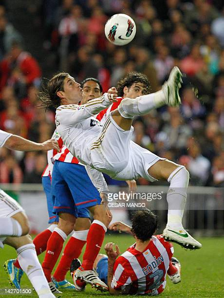 Real Madrid's defender Sergio Ramos kicks the ball during the Spanish league football match Atletico Madrid against Real Madrid at the Vicente...