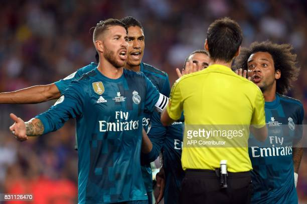 Real Madrid's defender Sergio Ramos Real Madrid's French defender Raphael Varane and Real Madrid's Brazilian defender Marcelo protest to the referee...