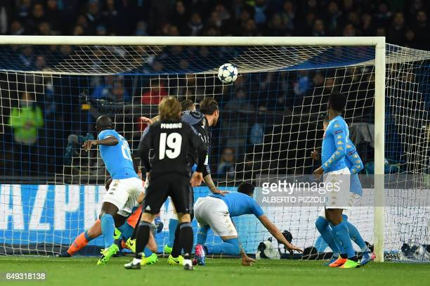 Real Madrid's defender Sergio Ramos scores a second goal during the UEFA Champions League football match SSC Napoli vs Real Madrid on March 7 2017 at...