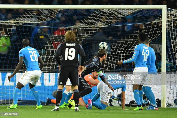 TOPSHOT Real Madrid's defender Sergio Ramos scores during the UEFA Champions League football match SSC Napoli vs Real Madrid on March 7 2017 at the...