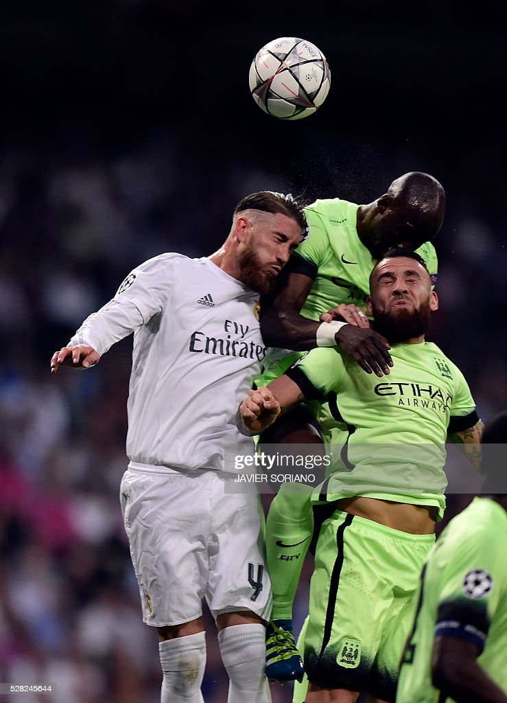 Real Madrid's defender Sergio Ramos (L) vies with Manchester City's French defender Eliaquim Mangala (C) and Manchester City's Argentinian defender Nicolas Otamendi (R) during the UEFA Champions League semi-final second leg football match Real Madrid CF vs Manchester City FC at the Santiago Bernabeu stadium in Madrid, on May 4, 2016. / AFP / JAVIER