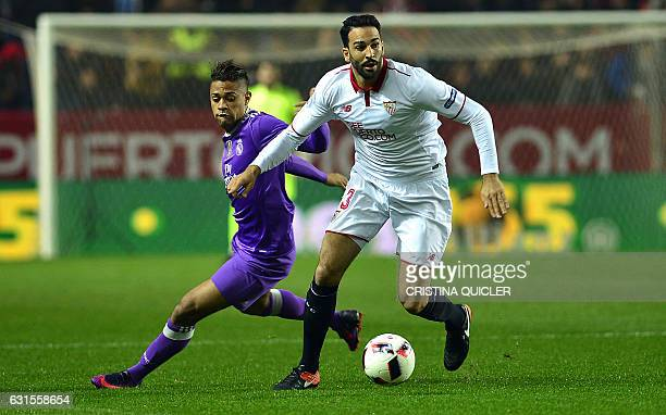 Real Madrid's Domenican forward Mariano vies Sevilla's French defender Adil Rami during the Spanish Copa del Rey round of 16 second leg football...