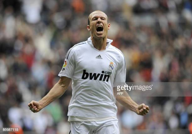 Real Madrid's Dutch Arjen Robben celebrates after scoring his team's second goal during a Spanish league football match against Valladolid at the...