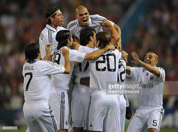 Real Madrid's Dutch striker Ruud Van Nistelrooy is surrounded by teammates after scoring against Atletico Madrid during a Spanish league football...