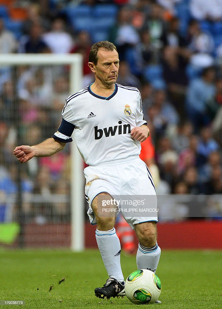 Real Madrid's Emilio Butragueno kicks the ball during the Corazon Classic Match 2013 - Veracruz charity football match Real Madrid Legends vs Juventus Turin Veterans at the Santiago Bernabeu stadium in Madrid on June 9, 2013.