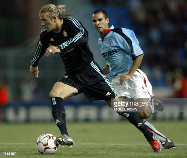 Real Madrid's English player David Beckham fights for the ball with Celta de Vigo's Angel Lopez during the Spanish league soccer match in Balaidos...