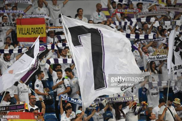Real Madrid's fans wave a giant flag with the number '7' of Real Madrid's forward from Portugal Cristiano Ronaldo before the UEFA Champions League...