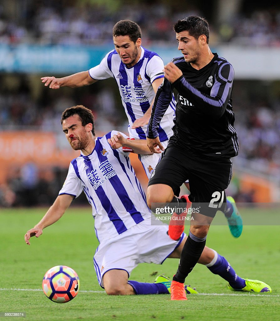 Real Madrid's forward Alvaro Borja Morata vies with Real Sociedad's defender Mikel Gonzalez and defender Joseba Zaldua during the Spanish league...