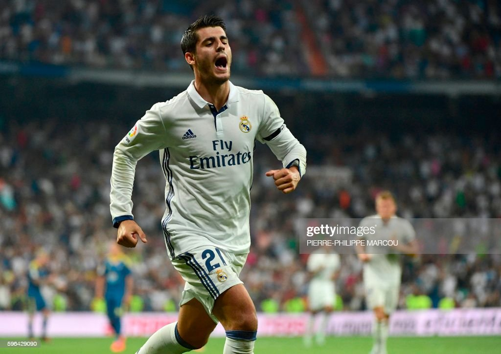 Real Madrid's forward Alvaro Morata celebrates after scoring during the Spanish league football match Real Madrid CF vs RC Celta de Vigo at the...