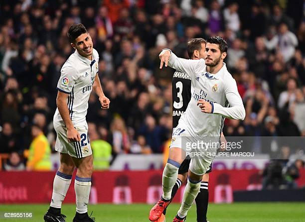 Real Madrid's forward Alvaro Morata celebrates after scoring during the Spanish league football match Real Madrid CF vs RC Deportivo at the Santiago...