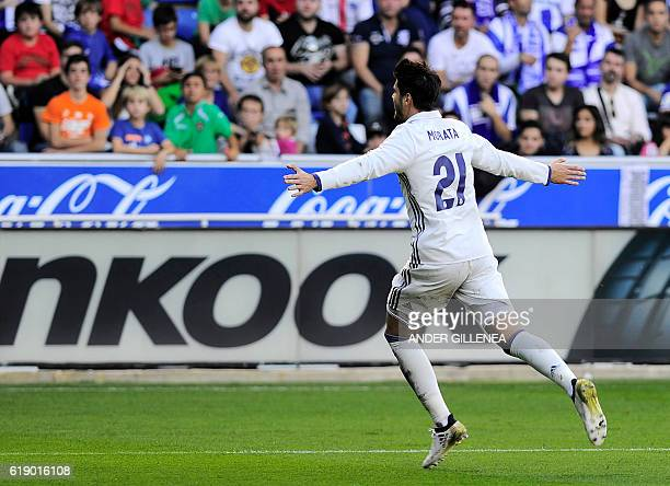 Real Madrid's forward Alvaro Morata celebrates after scoring his team's third goal during the Spanish league football match between Deportivo Alaves...