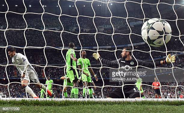 Real Madrid's forward Alvaro Morata celebrates after scoring past Sporting's goalkeeper Rui Patricio during the UEFA Champions League football match...