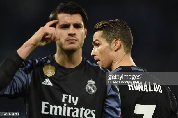 Real Madrid's forward Alvaro Morata celebrates next to Real Madrid's Portuguese forward Cristiano Ronaldo after scoring at the end of the UEFA...