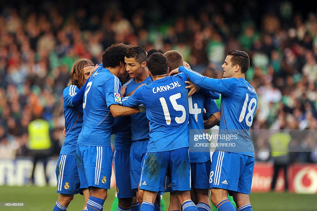 Real Madrid's forward Alvaro Morata (R) celebrates with his teammates after scoring during the Spanish league football match Real Betis vs Real Madrid on January 18, 2014 at the Benito Villamarin stadium in Sevilla.