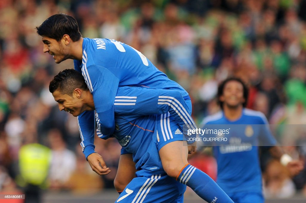 Real Madrid's forward Alvaro Morata (R) celebrates with Portuguese forward Cristiano Ronaldo after scoring during the Spanish league football match Real Betis vs Real Madrid on January 18, 2014 at the Benito Villamarin stadium in Sevilla.