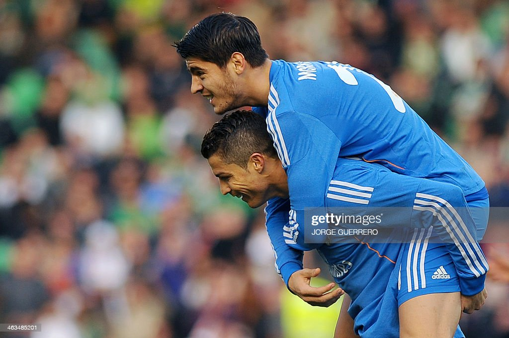 Real Madrid's forward Alvaro Morata (L) celebrates with Portuguese forward Cristiano Ronaldo after scoring during the Spanish league football match Real Betis vs Real Madrid on January 18, 2014 at the Benito Villamarin stadium in Sevilla.