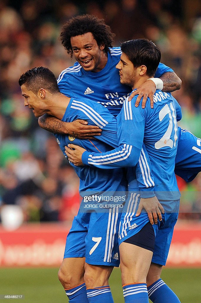 Real Madrid's forward Alvaro Morata (R) celebrates with Real Madrid's Brazilian defender Marcelo and Real Madrid's Portuguese forward Cristiano Ronaldo after scoring during the Spanish league football match Real Betis vs Real Madrid on January 18, 2014 at the Benito Villamarin stadium in Sevilla.