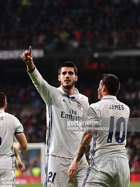 Real Madrid's forward Alvaro Morata celebrates with Real Madrid's Colombian midfielder James Rodriguez after scoring during the Spanish league...