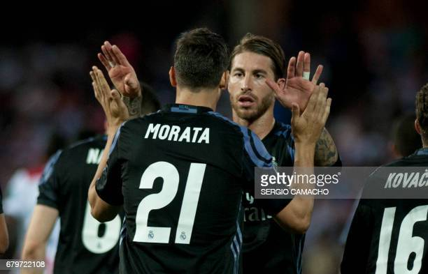 Real Madrid's forward Alvaro Morata celebrates with Real Madrid's defender Sergio Ramos during the Spanish league football match Granada FC vs Real...