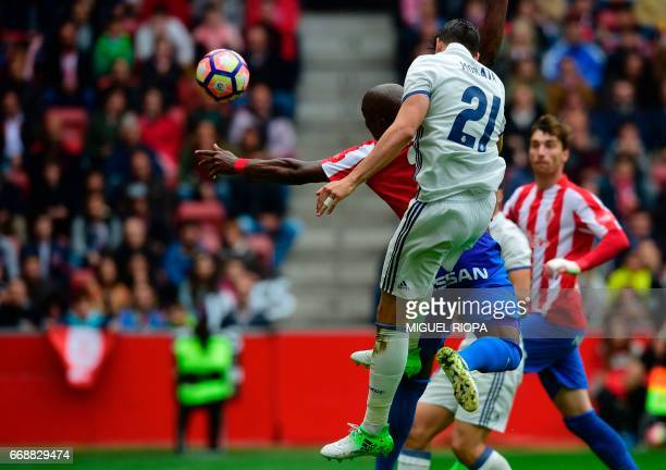 Real Madrid's forward Alvaro Morata heads the ball to score a goal during the Spanish league football match Real Sporting de Gijon vs Real Madrid CF...