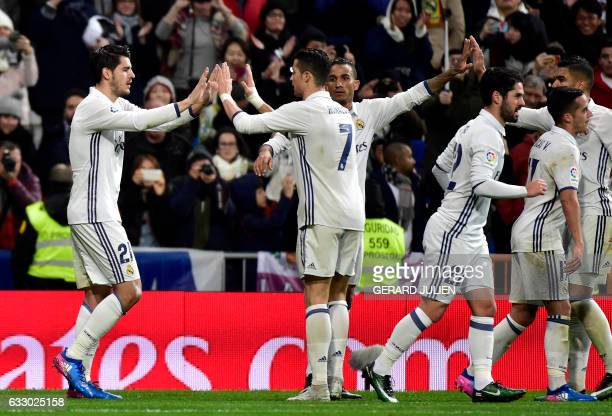Real Madrid's forward Alvaro Morata is congratulated by Real Madrid's Portuguese forward Cristiano Ronaldo after scoring a goal during the Spanish...