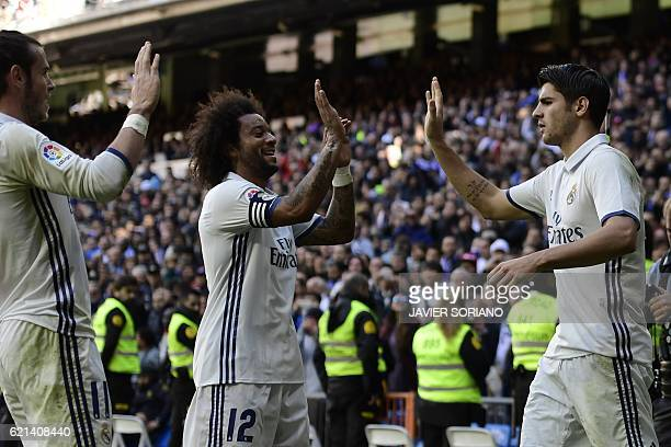 Real Madrid's forward Alvaro Morata Real Madrid's Brazilian defender Marcelo and Real Madrid's Welsh forward Gareth Bale celebrate after scoring a...