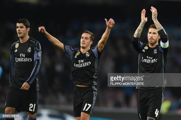 Real Madrid's forward Alvaro Morata Real Madrid's midfielder Lucas Vazquez and Real Madrid's defender Sergio Ramos celebrate at the end of the UEFA...