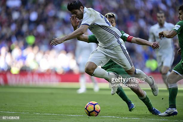 Real Madrid's forward Alvaro Morata scores past Leganes's Italian defender Mantovani during the Spanish league football match Real Madrid CF vs Club...