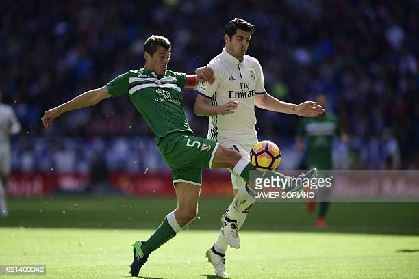 Real Madrid's forward Alvaro Morata vies with Leganes's Italian defender Mantovani during the Spanish league football match Real Madrid CF vs Club...