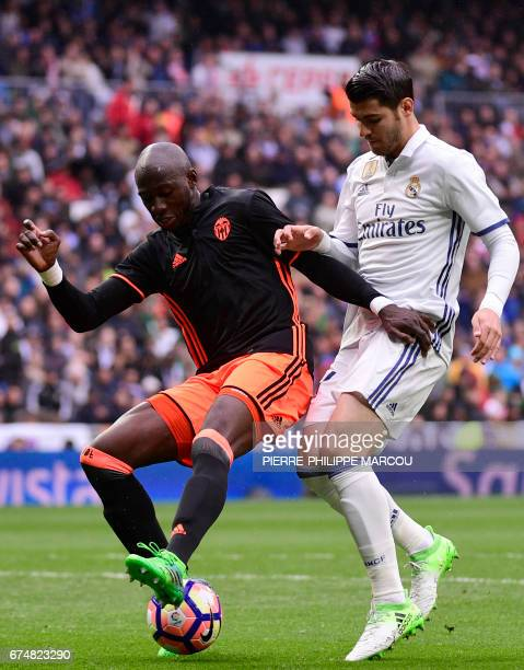 Real Madrid's forward Alvaro Morata vies with Valencia's French defender Eliaquim Mangala during the Spanish league football match Real Madrid CF vs...