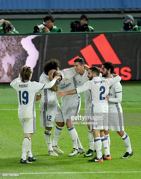 Real Madrid's forward Cristiano Ronaldo is congratulated by his teammates after his second goal against Kashima Antlers during the Club World Cup...