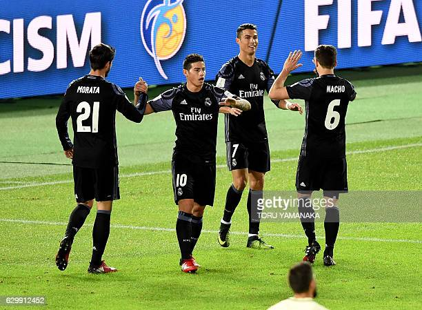 Real Madrid's forward Cristiano Ronaldo is congratulated by teammates Alvaro Morata James Rodriguez and Nacho Fernande after scoring a goal during...