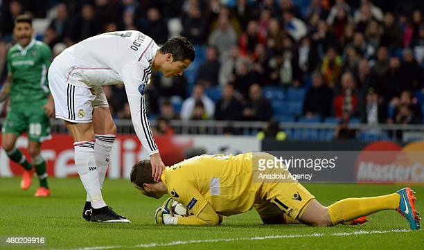 Real Madrid's forward Cristiano Ronaldo touches the nape of Ludogorets' goalkeeper Vladislav Stoyanov during the UEFA Champions League Group B...