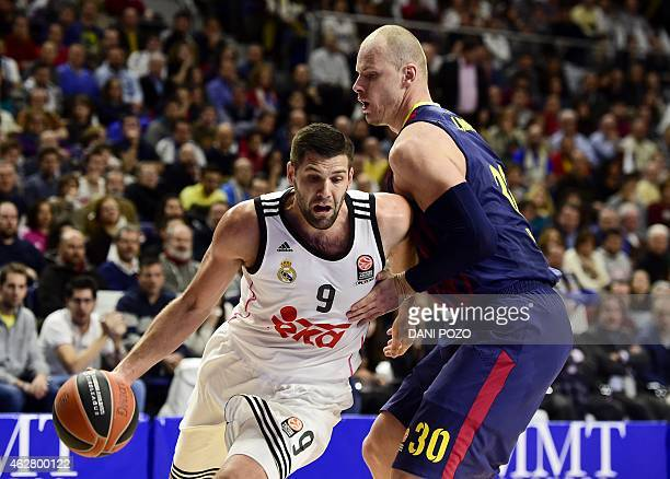 Real Madrid's forward Felipe Reyes vies with Barcelona's Polish centre Maciej Lampe during the Euroleague basketball Top 16 round 6 match Real Madrid...