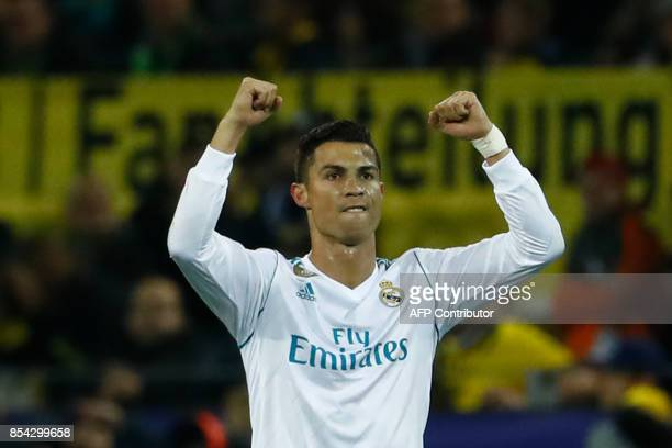 Real Madrid's forward from Portugal Cristiano Ronaldo celebrates scoring during the UEFA Champions League Group H football match BVB Borussia...