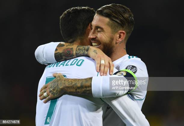 Real Madrid's forward from Portugal Cristiano Ronaldo celebrates scoring with Real Madrid's defender from Spain Sergio Ramos during the UEFA...