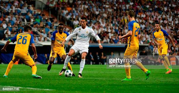 TOPSHOT Real Madrid's forward from Portugal Cristiano Ronaldo controls the ball during the UEFA Champions League football match Real Madrid CF vs...