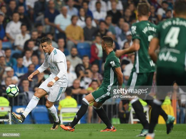 Real Madrid's forward from Portugal Cristiano Ronaldo controls the ball during the Spanish league football match Real Madrid CF against Real Betis at...