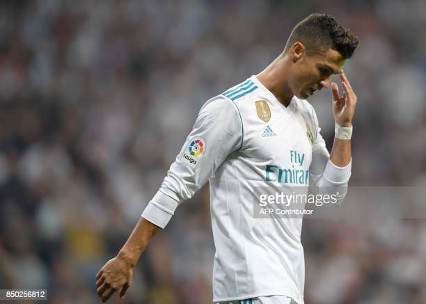 Real Madrid's forward from Portugal Cristiano Ronaldo gestures during the Spanish league football match Real Madrid CF against Real Betis at the...