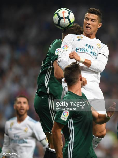 Real Madrid's forward from Portugal Cristiano Ronaldo heads the ball during the Spanish league football match Real Madrid CF against Real Betis at...