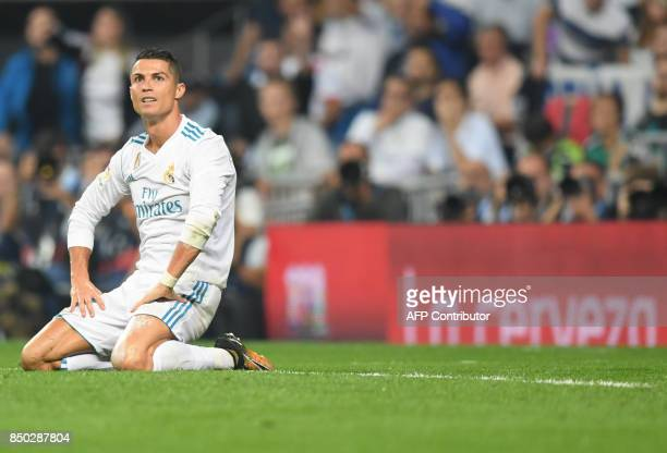 Real Madrid's forward from Portugal Cristiano Ronaldo kneels on the field during the Spanish league football match Real Madrid CF against Real Betis...
