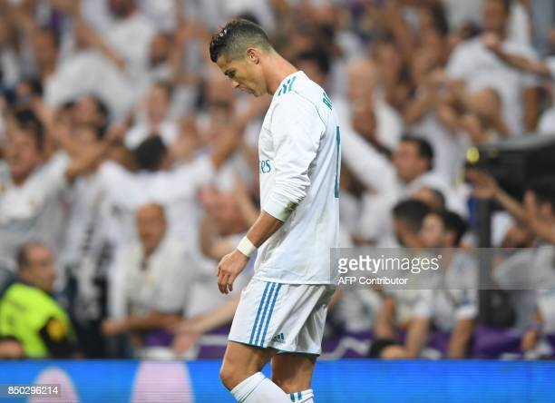 Real Madrid's forward from Portugal Cristiano Ronaldo looks downwards during the Spanish league football match Real Madrid CF against Real Betis at...