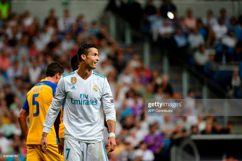 Real Madrid's forward from Portugal Cristiano Ronaldo looks on during the UEFA Champions League football match Real Madrid CF vs APOEL FC at the Santiago Bernabeu stadium in Madrid on September 13, 2017. /